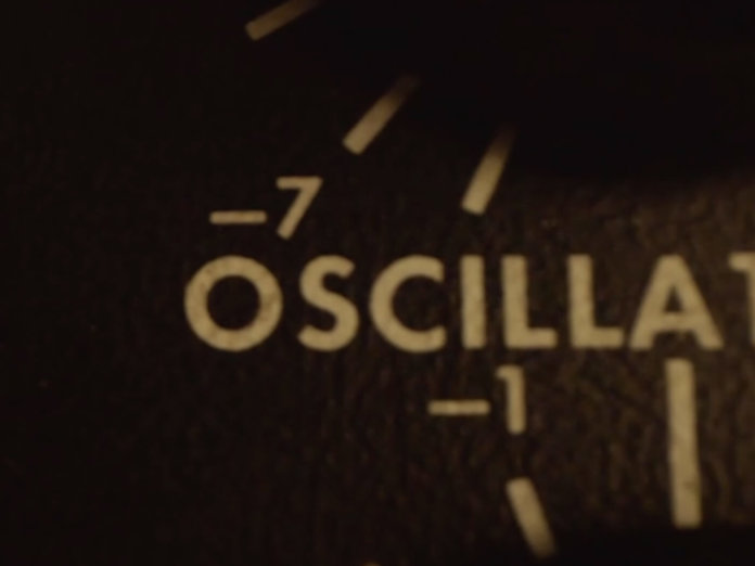 Close-up of synthesizer front panel marked Oscillator