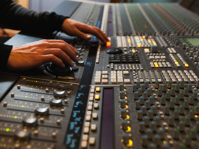 Hands on a mixing desk