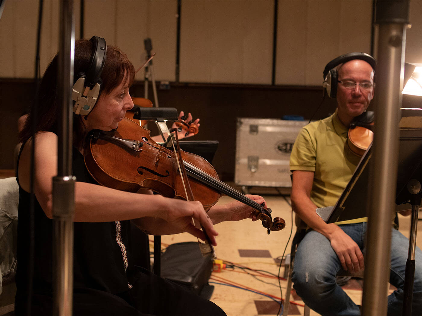 Violinist recording in orchestra